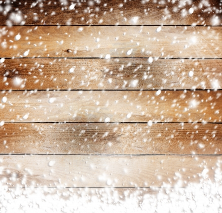 holiday celebration: Old wooden background with snow for design