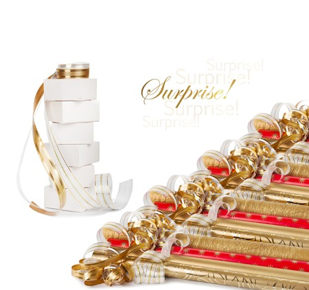 Gift boxes and rolls of wrapping paper with multicolored streamers for gifts isolated on white background photo