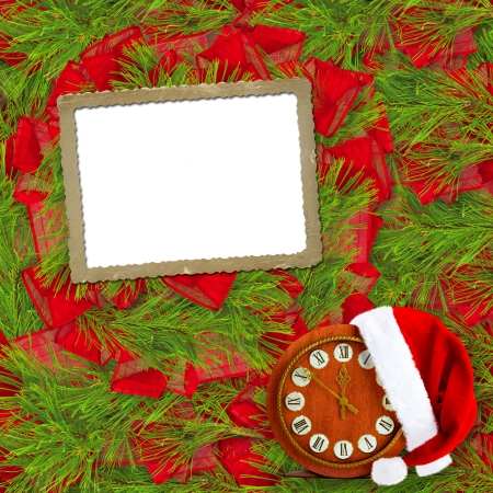 Santa Claus hat, clock and Christmas tree with frame on the abstract background photo
