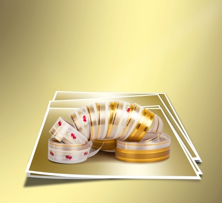 Gold paper horizontal ribbon on the gold abstract  photo