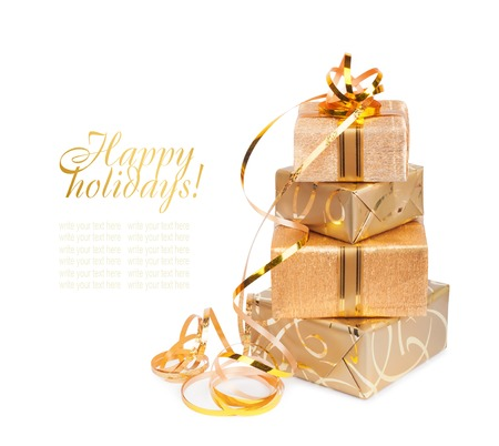 Beautiful  Gift box in gold wrapping paper isolated on a white background photo