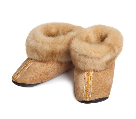 Slippers made ??of natural goat fur with lace photo