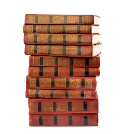A stack of old books with gold stamping on a white background isolated  photo