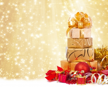 gift wrapping: Gift box in gold wrapping paper on a beautiful abstract background