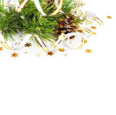 lacet: Christmas fir branch with pine cones, gold streamers and stars on a white isolated