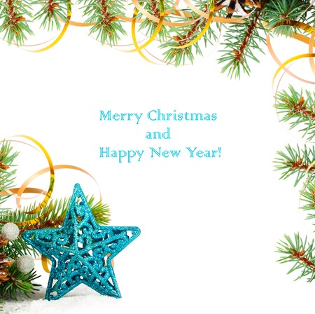 lacet: Christmas tree branch with gold serpentine and star on white background isolated