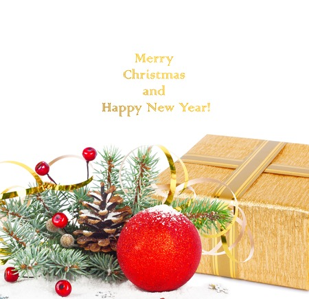 lacet: Christmas tree branch with gold serpentine, gift box and red sphere on white background isolated
