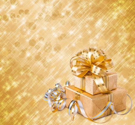 Gift box in gold wrapping paper on a beautiful abstract background photo