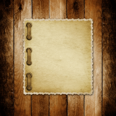 Grunge paper for invitation on the vintage wooden background photo