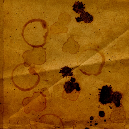 Old crumpled paper with stains of coffee or tea photo
