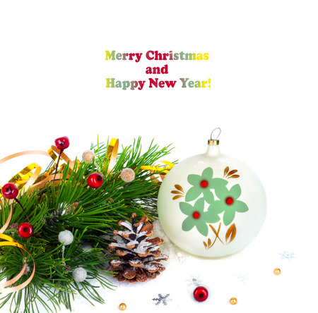 Christmas tree branch with gold serpentine and vintage sphere on white background isolated photo