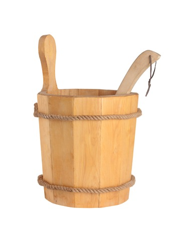 Wooden bucket with ladle for the sauna Isolated on white  photo