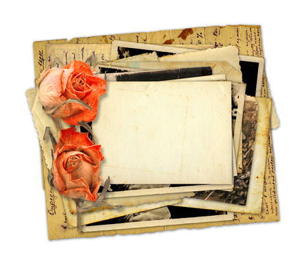 Pile of old photos and letters with bouquet of dried roses on white background isolated Stock Photo