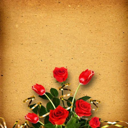 Old vintage album for photos with a bouquet of red roses and tulips