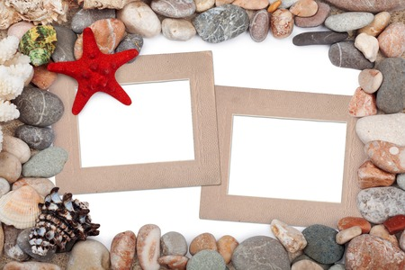 Paper Vintage photo frame with red starfish and pebbles photo