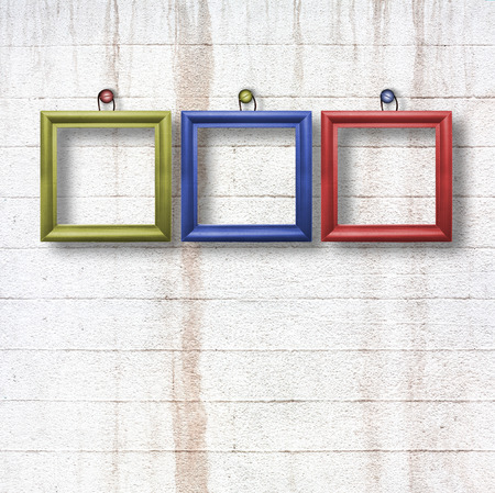 Multicolored  wooden frames for pictures on old stone wall photo