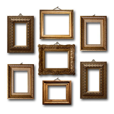 Gilded wooden frames for pictures on white isolated background  Foto de archivo