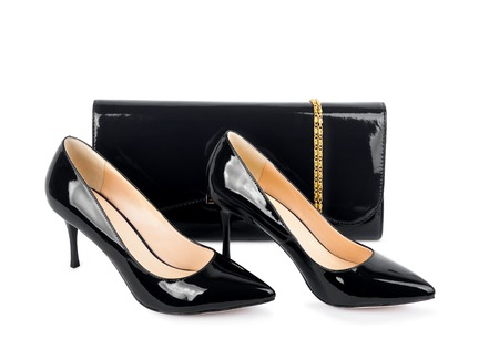 clutches: Beautiful black shoes with clutches on white isolated background
