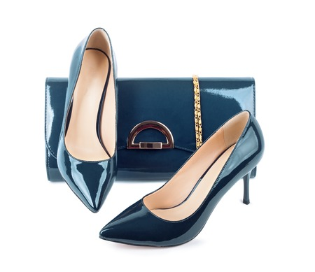 clutches: Beautiful blue shoes with clutches on white isolated background