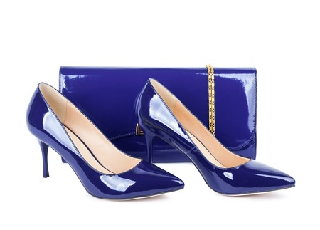 Beautiful violet shoes with clutches on white isolated background photo