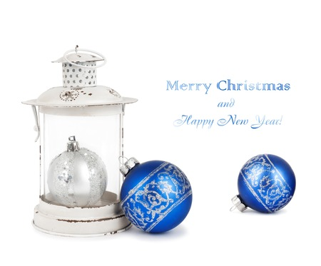 Blue and silver Christmas balls and vintage lantern isolated on white background photo