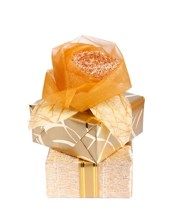 Beautiful gift box in gold paper with a silk rose isolated on a white background photo