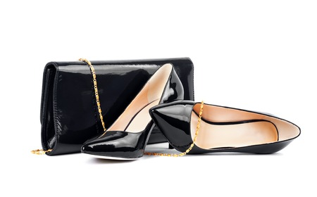 clutches: Beautiful  black shoes with clutches on white isolated
