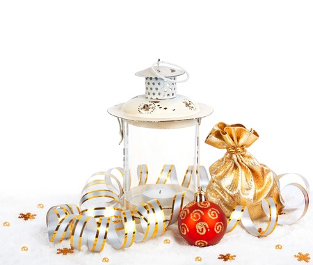 Red christmas ball, golden bag with gifts and the old vintage lamp isolated on white background photo