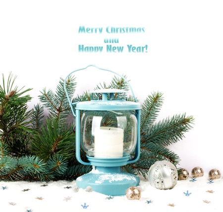 metall lamp: Snowy blue lantern and Christmas balls on the background of fir branches