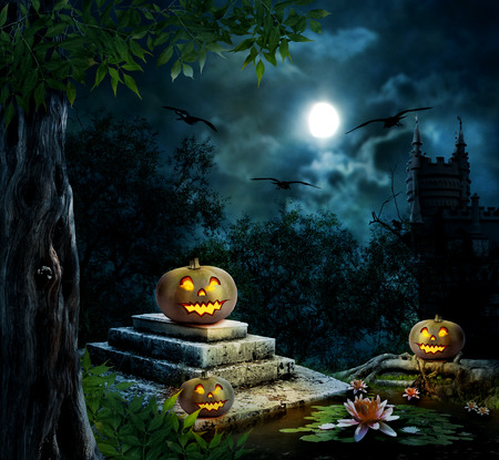 Halloween pumpkins in yard of old house night in bright moonlight  photo