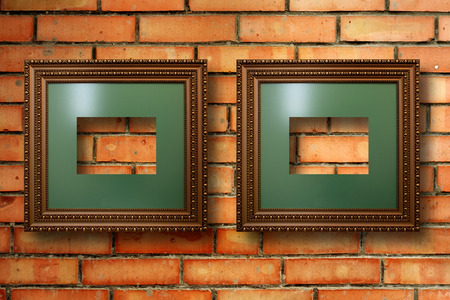 Vintage wooden frames for pictures on old brick wall photo