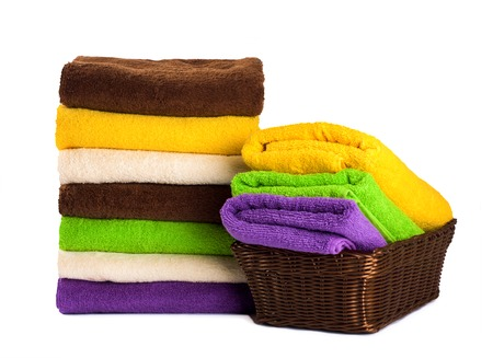 Stack of clean fresh towels isolated on white background photo