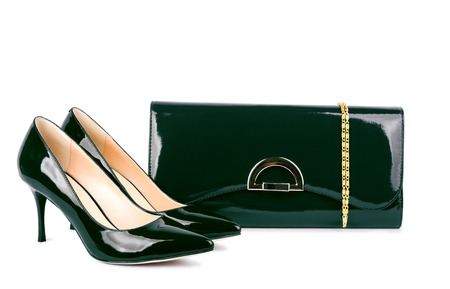 Beautiful green shoes with clutches on white isolated background photo