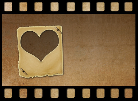 february 14th: Old paper slides in the form of hearts on abstract grunge background