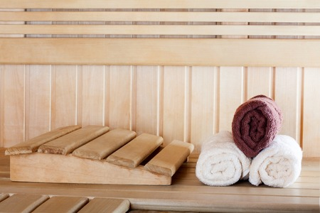 finnish bath: Traditional wooden sauna for relaxation with set of clean towels Stock Photo