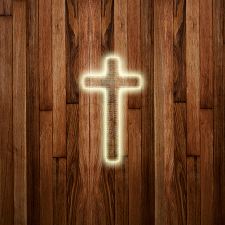 good spirits: Glowing holy cross on abstract wooden background