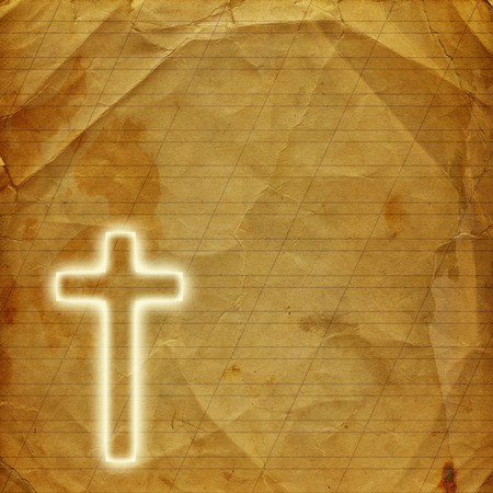 good spirits: Glowing holy cross on abstract paper background Stock Photo