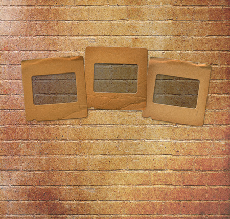 alienated: Old paper slides for photos on rusty abstract background Stock Photo