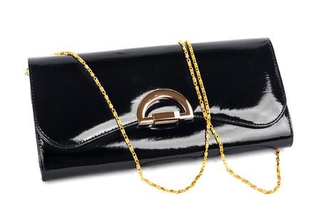 lacquered: Elegant ladies black handbag isolated on white background