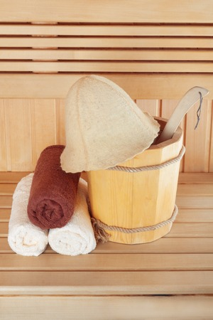 finnish bath: Traditional wooden sauna for relaxation with bucket of water and set of clean towels