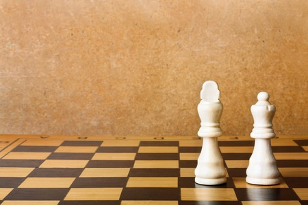 dominating: One chess king dominating another on the chessboard
