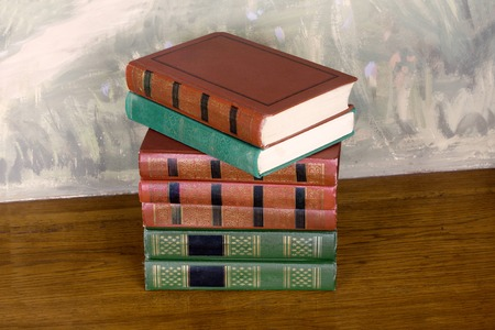 richly: Richly decorated volumes of books with a gold lettering on the beautiful wooden shelf
