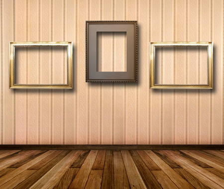 striped wallpaper: Interior of room with striped wallpaper and gold wooden frames for paintings Stock Photo