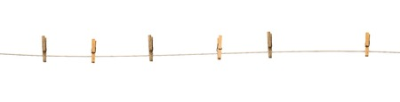 clench: Old wooden clothespins on a rope isolated on  white background Stock Photo