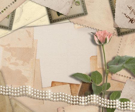 old letters: Old vintage archive with photos, letters, pearls and pink roses Stock Photo