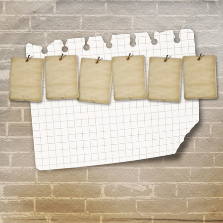 advertisements: Old vintage sheets for advertisements on brick wall background