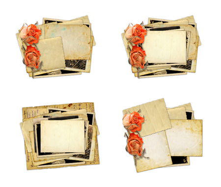 Pile of old photos and letters with bouquet of dried roses on white background isolated. Set Stock Photo