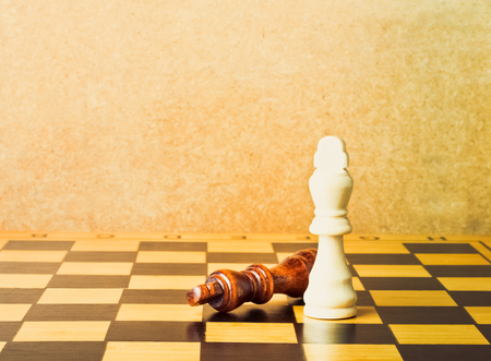 One chess king dominating another on the chessboard
