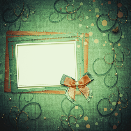 old photograph: Old vintage photo album with beautiful bows and lace