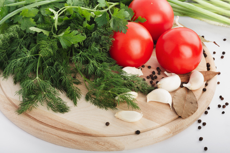 Fresh raw tomatoes, green onions, parsley and dill on white  background Stock Photo